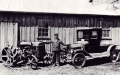 Farmer with Tractor and Model T